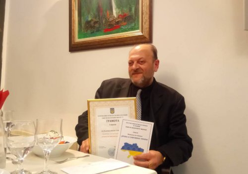 URI Europe Global Council Trustee won first prize at literary competition